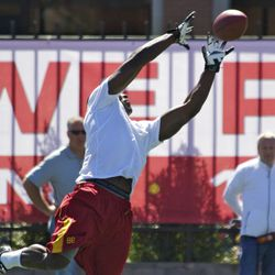Marqise Lee goes up for a ball.