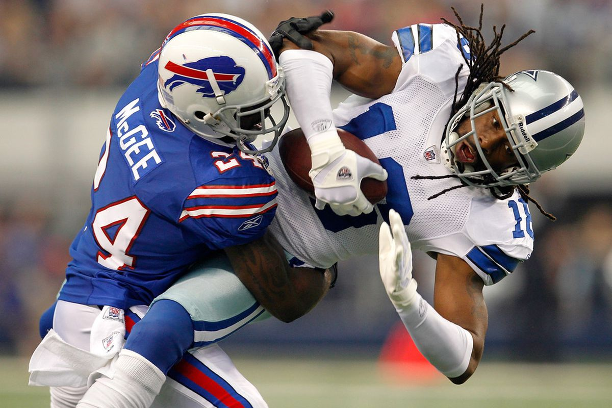 ARLINGTON, TX - NOVEMBER 13:  Jesse Holley #16 of the Dallas Cowboys pulls in a pass against Terrence McGee #24 of the Buffalo Bills at Cowboys Stadium on November 13, 2011 in Arlington, Texas.  (Photo by Tom Pennington/Getty Images)