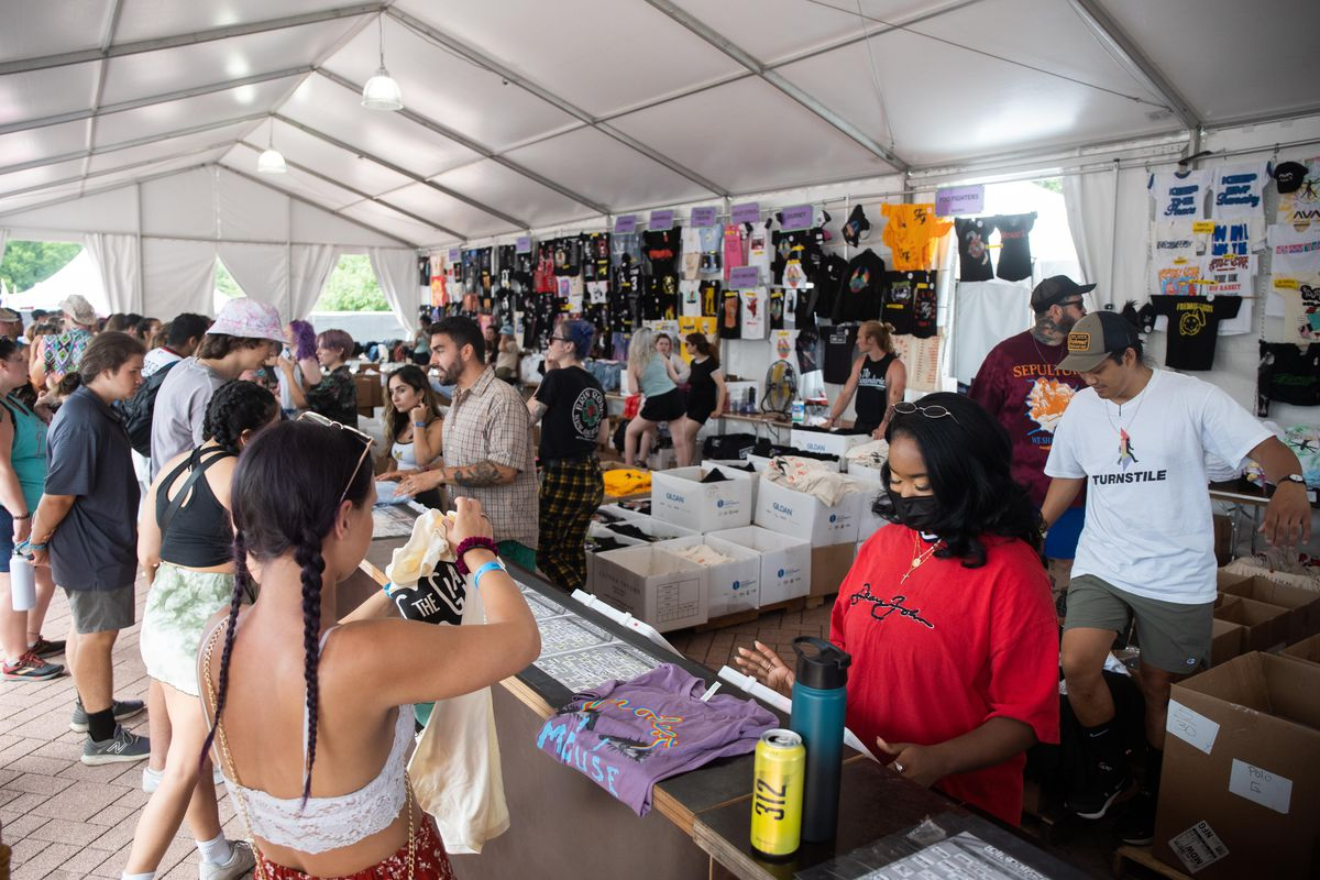 People buying band t-shirts on the second day of Lollapalooza at Grant Park, Friday afternoon, July 30, 2021.