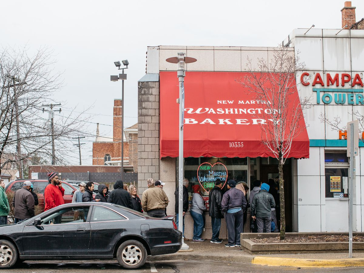 Customers line up beneath the red awning for New Martha Washington and down the street on a gloomy Paczki Day.