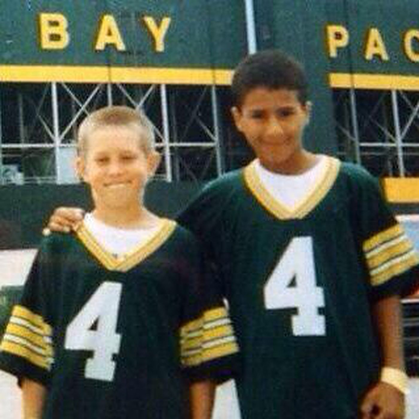 best sneakers 357c9 f531c Photo of young Colin Kaepernick wearing a Packers jersey ...
