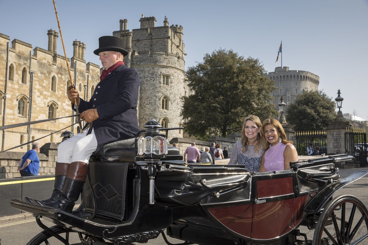 """NBC """"Today"""" hosts Hoda Kotb and Savannah Guthrie sitting in an open carriage in Windsor, England"""