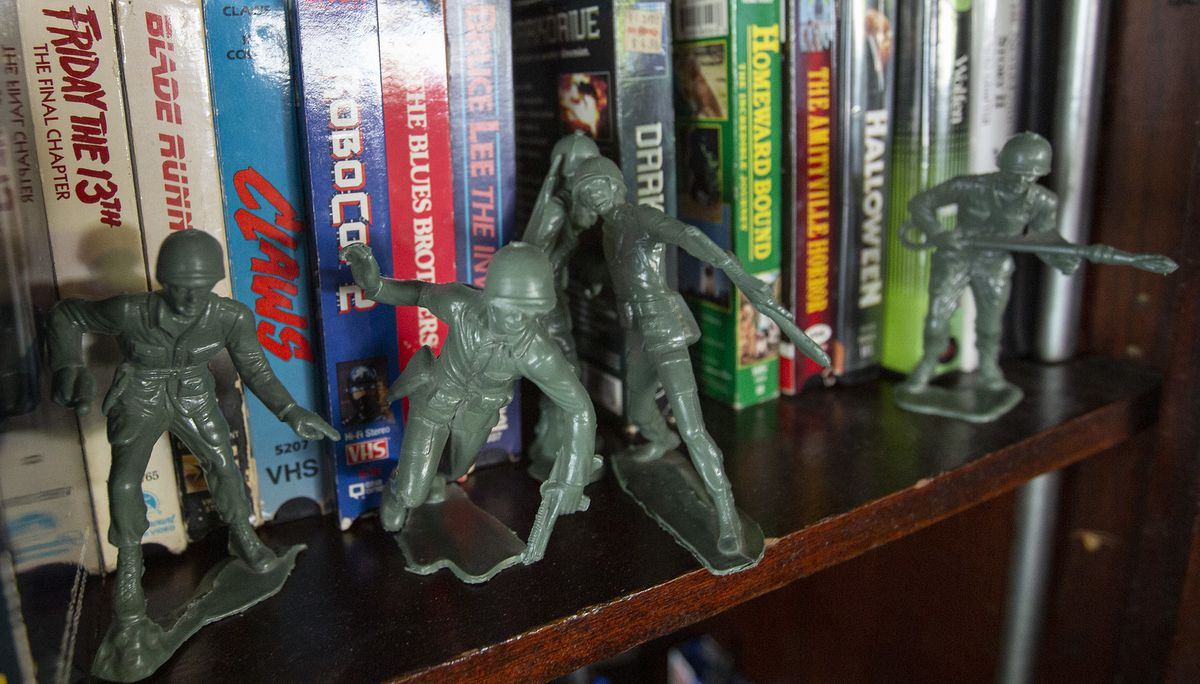 toy soldiers and a collection of vhs tapes