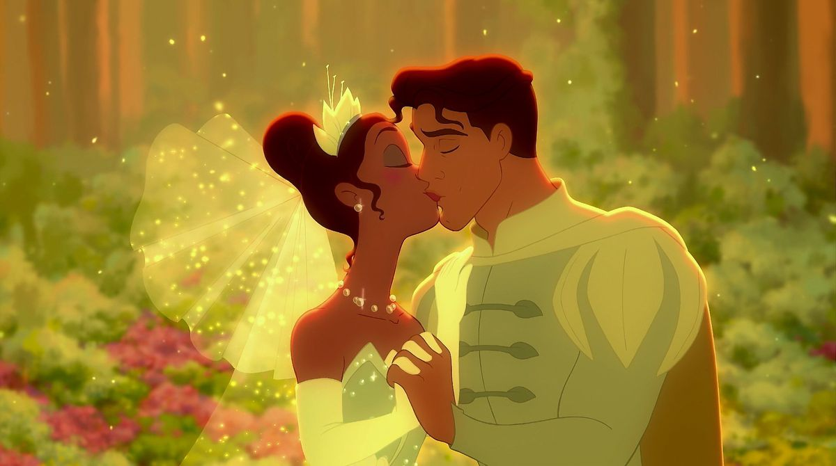 Tiana and the de-frogged prince share a smooch.