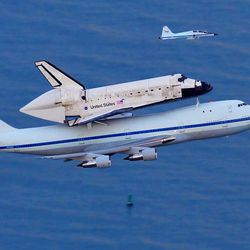 The Space shuttle Discovery, mounted on top of a modified 747, flies over the Atlantic Ocean as it makes a low pass over Cocoa Beach, Fla. for the final time heading to Washington D.C. and the Smithsonian.  On Thursday, it will be towed to its permanent installation at the Smithsonian's annex in northern Virginia.