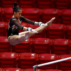 Utah's Alani Sabado eyes the upper bar as she performs as Utah and Washington compete in an NCAA gymnastics meet at the Huntsman Center in Salt Lake City on Saturday, Jan. 30, 2021. No. 4 Utah won 197.475 to 193.300.