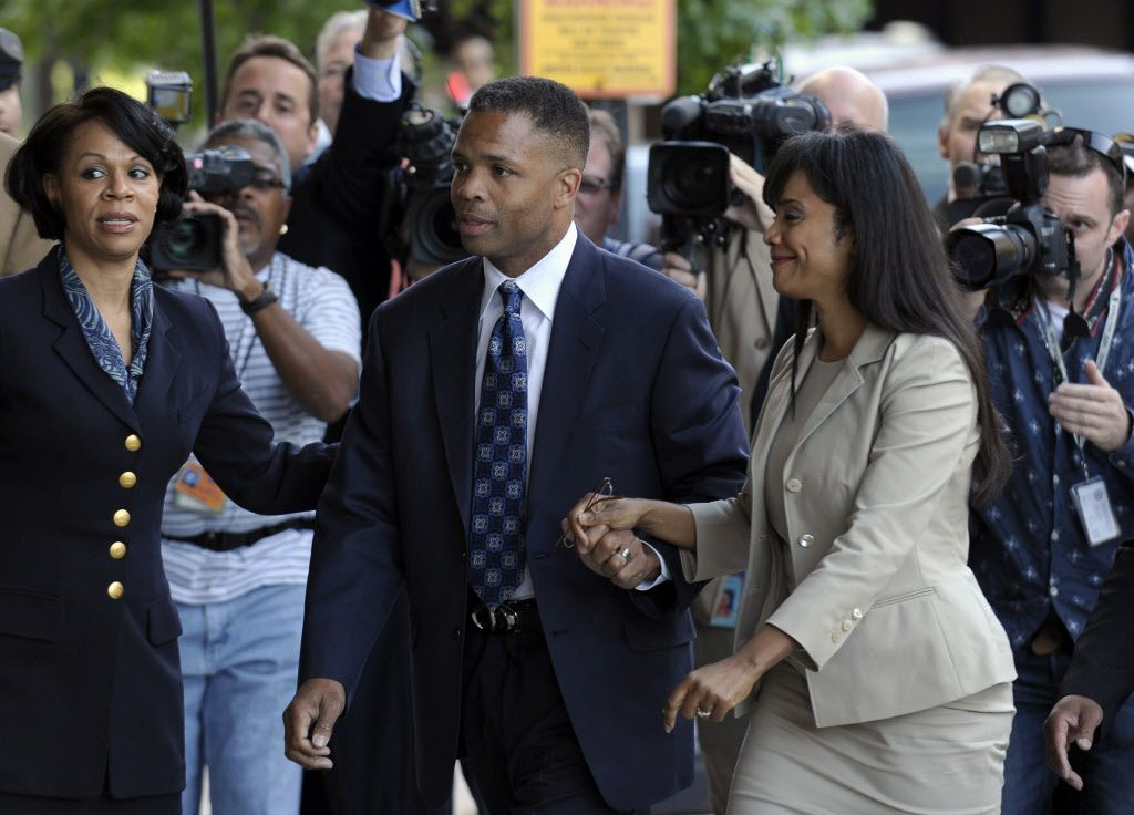 Former Rep. Jesse Jackson Jr. and his wife, Sandi, arrive at federal court in Washington for their sentencing in 2013. | AP File Photo/Susan Walsh