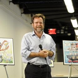 In this photo provided by Politico, Politico cartoonist Matt Wuerker speaks after an announcement of winning the 2012 Pulitzer for Editorial Cartooning at the company's headquarters in Arlington, Va., Monday, April 16, 2012. (AP Photo/Politico, John Shinkle)