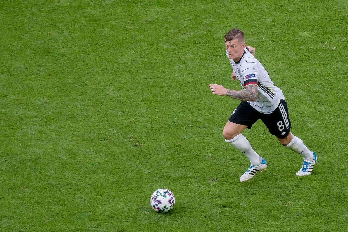 Toni Kroos of Germany controls the ball during the UEFA Euro 2020 Championship Group F match between Portugal and Germany at Football Arena Munich on June 19, 2021 in Munich, Germany.