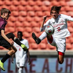 Morgan's Rory Williams and Judge Memorial's Connor Marland try to knock the ball down in the 3A boys soccer championship at Rio Tinto Stadium in Sandy on Tuesday, May 18, 2021.