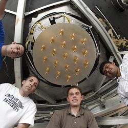 David Carter, Mike Elmer, Karl Warnick, and Vikas Asthana at the Puerto Rico Arecibo Radio Observatory, the largest radio telescope on Earth, installing a multi phase antenna.