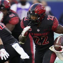 San Diego State running back Greg Bell (22) runs the ball during the second half of an NCAA college football game against Utah Saturday, Sept. 18, 2021, in Carson, Calif.