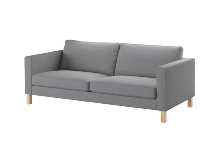 Rectangular, two-seat gray sofa.