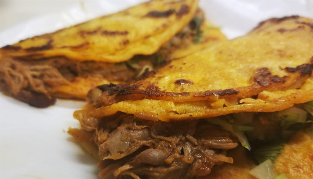 Two crispy tacos with beef