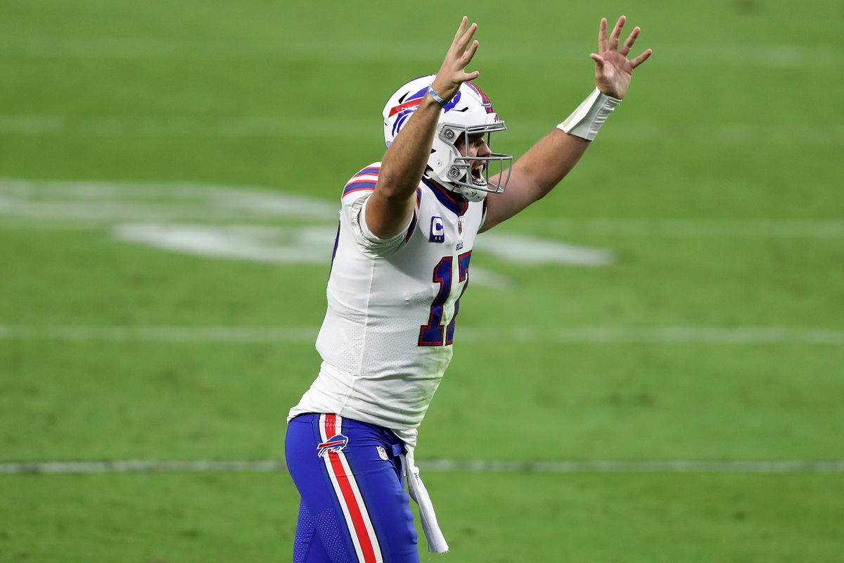 Josh Allen of the Buffalo Bills celebrates after Devin Singletary scored a two yard touchdown against the Las Vegas Raiders during the fourth quarter in the game at Allegiant Stadium on October 04, 2020 in Las Vegas, Nevada.