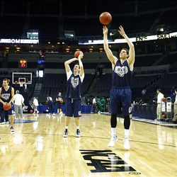 BYU's Jimmer Fredette, right, Noah Hartsock and Jackson Emery practice Wednesday at the Ford Center in Oklahoma City in preparation for their Thursday first round NCAA game against Florida.