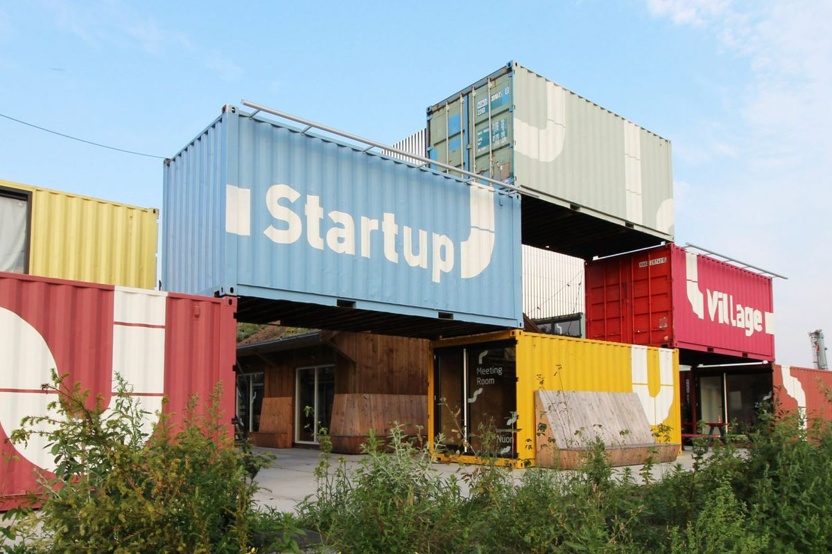 Stacked shipping containers form a building.