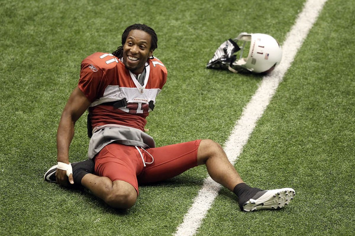 FLAGSTAFF AZ - AUGUST 01:  Wide receiver Larry Fitzgerald #11 of the Arizona Cardinals warms up for training camp at Northern Arizona University Walkup Skydome on August 1 2010 in Flagstaff Arizona.  (Photo by Christian Petersen/Getty Images)