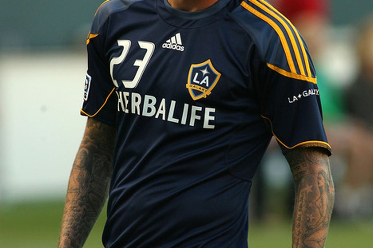 CARSON, CA - AUGUST 06:  David Beckham #23 of the Los Angeles Galaxy smiles as he warms up before the game against FC Dallas at The Home Depot Center on August 6, 2011 in Carson, California.  (Photo by Jeff Golden/Getty Images)