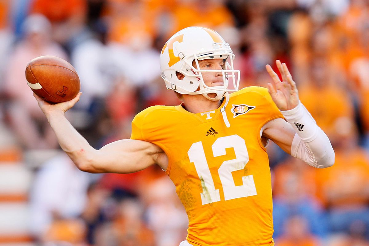 KNOXVILLE, TN - OCTOBER 15:  Matt Simms #12 of the Tennessee Volunteers looks to pass against the LSU Tigers at Neyland Stadium on October 15, 2011 in Knoxville, Tennessee.  (Photo by Kevin C. Cox/Getty Images)
