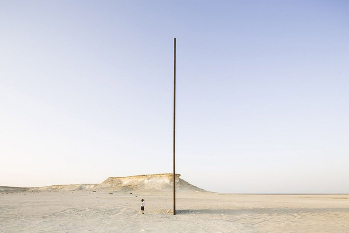 "All photos via<a href=""http://www.archdaily.com/626191/richard-serra-s-east-west-west-east-rises-in-the-qatari-desert/""> ArchDaily</a>"