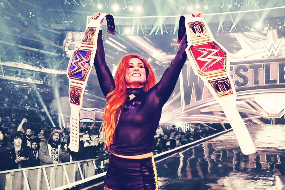 Becky Lynch, WWE champion, holding two title belts
