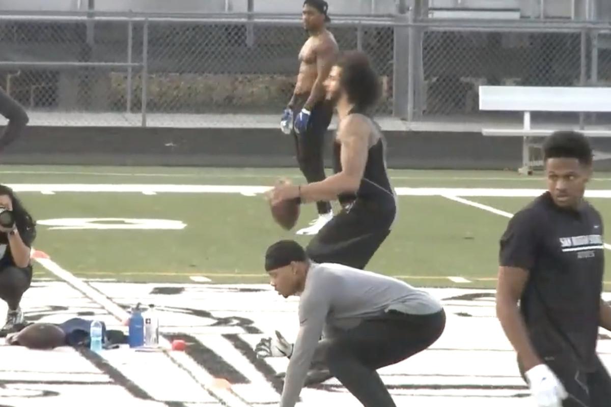 Colin Kaepernick taking a snap during his Atlanta workout