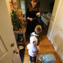 Patricia Abbott Lammi talks with her two kids Luke and Juliet before heading out the door for the day on Tuesday, May 2, 2017. Patricia and her husband Phillip work to juggle their work schedules to make things work with their two kids.
