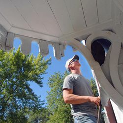 In this Sept. 8, 2012 photo, Chase Berryhill, from Landrus Construction & Roofing of Pontiac, works on the roofing of the historic Strevell House in Pontiac, Ill., during a full-scale renovation of the structure. The Livingston County Historical Society bought the Pontiac landmark, the last known structure in Livingston County to have hosted Abraham Lincoln before he was elected president.