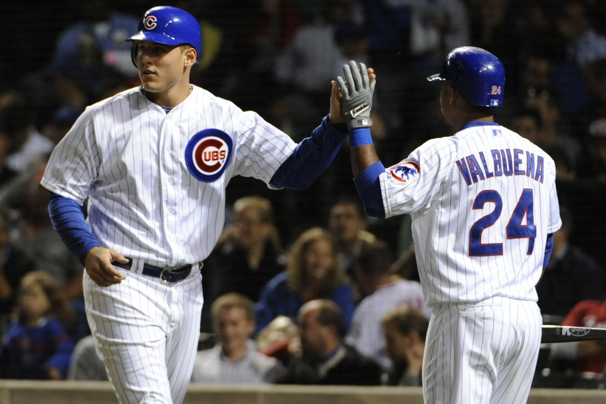 Anthony Rizzo of the Chicago Cubs is greeted by Luis Valbuena after scoring against the Cincinnati Reds at Wrigley Field in Chicago, Illinois.  (Photo by David Banks/Getty Images)