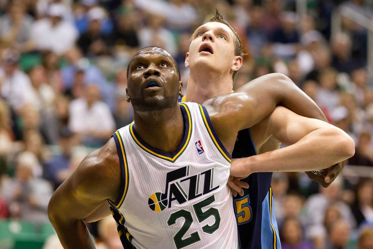March 23, 2012; Salt Lake City, UT, USA; Utah Jazz center Al Jefferson (25) boxes out Denver Nuggets center Timofey Mozgov (25) during the first quarter at Energy Solutions Arena. Mandatory Credit: Russ Isabella-US PRESSWIRE