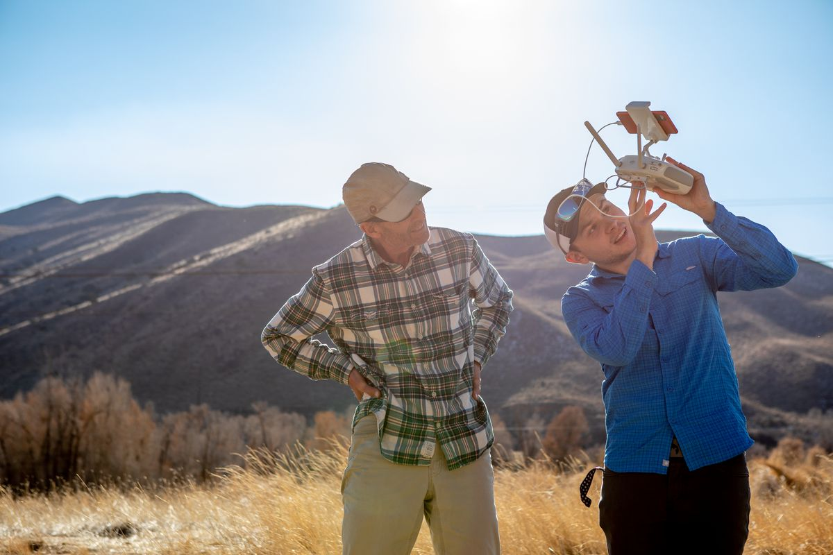 Weber State University geography student Timber Erickson, right, and professor Bryan Dorsey, left, use a drone to explore locations for a proposed wildlife crossing bridge over I-84 in Summit County on Tuesday, Nov. 3, 2020. The research is part of a senior project by Erickson.