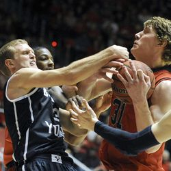 Brigham Young Cougars guard Tyler Haws (3) and Utah Utes center Dallin Bachynski (31) fight for a rebound during a game at the Jon M. Huntsman Center on Saturday, Dec. 14, 2013.