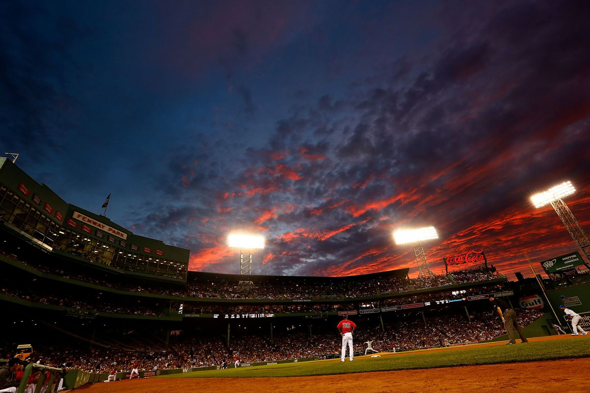 BOSTON, MA - JULY 20:  Aaron Laffey #32 of the Toronto Blue Jays pitches against the Boston Red Sox as the sun sets over Fenway Park during the game on July 20, 2012 in Boston, Massachusetts.  (Photo by Jared Wickerham/Getty Images)