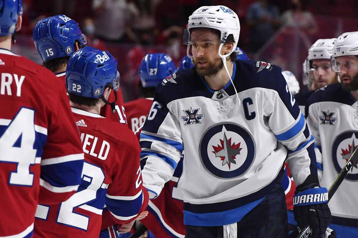 Jun 7, 2021; Montreal, Quebec, CAN; Montreal Canadiens forward Cole Caufield (22) and Winnipeg Jets forward Blake Wheeler (26) shake hands after game four of the second round of the 2021 Stanley Cup Playoffs at the Bell Centre. The Montreal Canadiens swept the series.