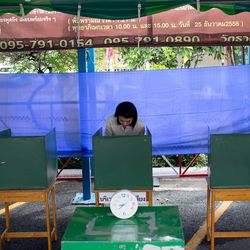 A voter casts a ballot at a polling station on August 7, 2016 in Bangkok, Thailand.