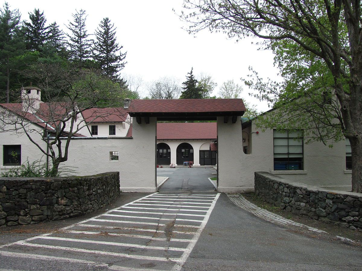 A private school as viewed through the one-lane entry gate.