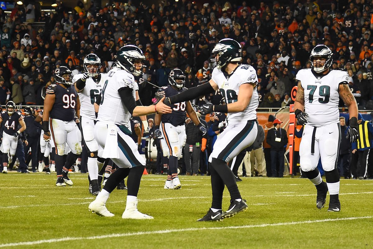 Nick Foles (left) celebrates with tight end Dallas Goedert (right) after throwing a 10-yard touchdown pass to Goedert the Eagles' 16-15 victory over the Bears in a wild-card playoff game at Soldier Field in 2019.