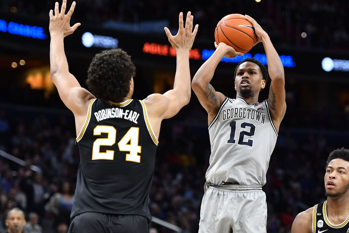 Georgetown Hoyas guard Terrell Allen shoots over Villanova Wildcats forward Jeremiah Robinson-Earl during the second half at Capital One Arena.