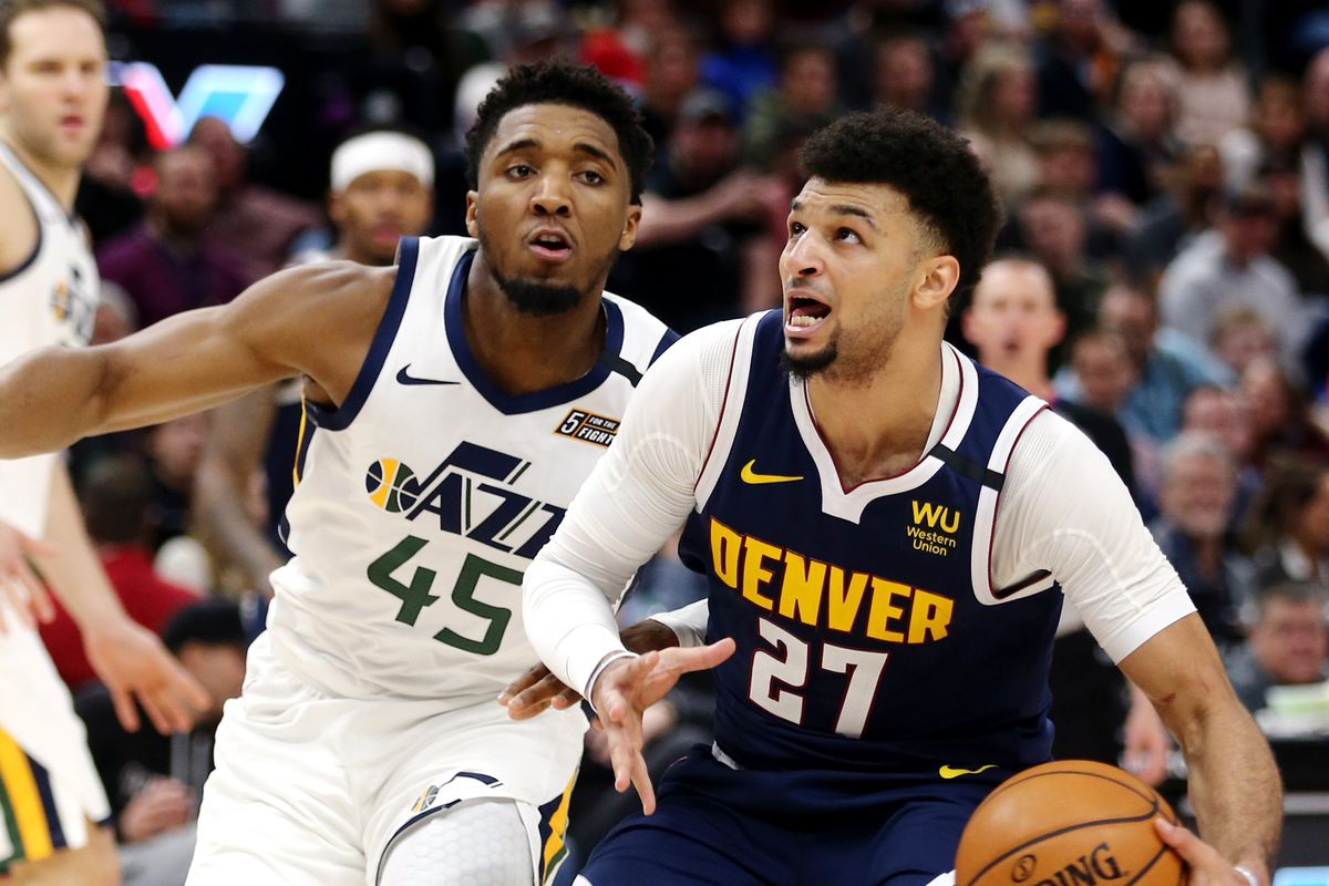 Utah Jazz guard Donovan Mitchell (45) can't keep up with Denver Nuggets guard Jamal Murray (27) as the Utah Jazz and the Denver Nuggets play an NBA basketball game at Vivint Arena in Salt Lake City on Wednesday, Feb. 5, 2020. Denver won 98-95, giving the Jazz its fifth straight loss.
