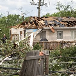 Sandra Baar, 65, of Dixon, helps clear out her sister's house on Janes Avenue near Evergreen Lane in Woodridge after a tornado ripped through the western suburbs overnight, Monday morning, June 21, 2021.