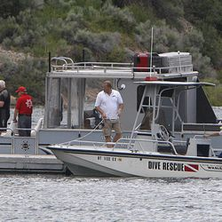 Rescue boats dock after finding the body of Kalem Franco, 17, of Heber City, drowned while swimming towards the island in 55 degree water at Deer Creek Island Beach while on a family outing at Deer Creek Reservoir Wednesday, June 29, 2011, in Wasatch County near Heber City.