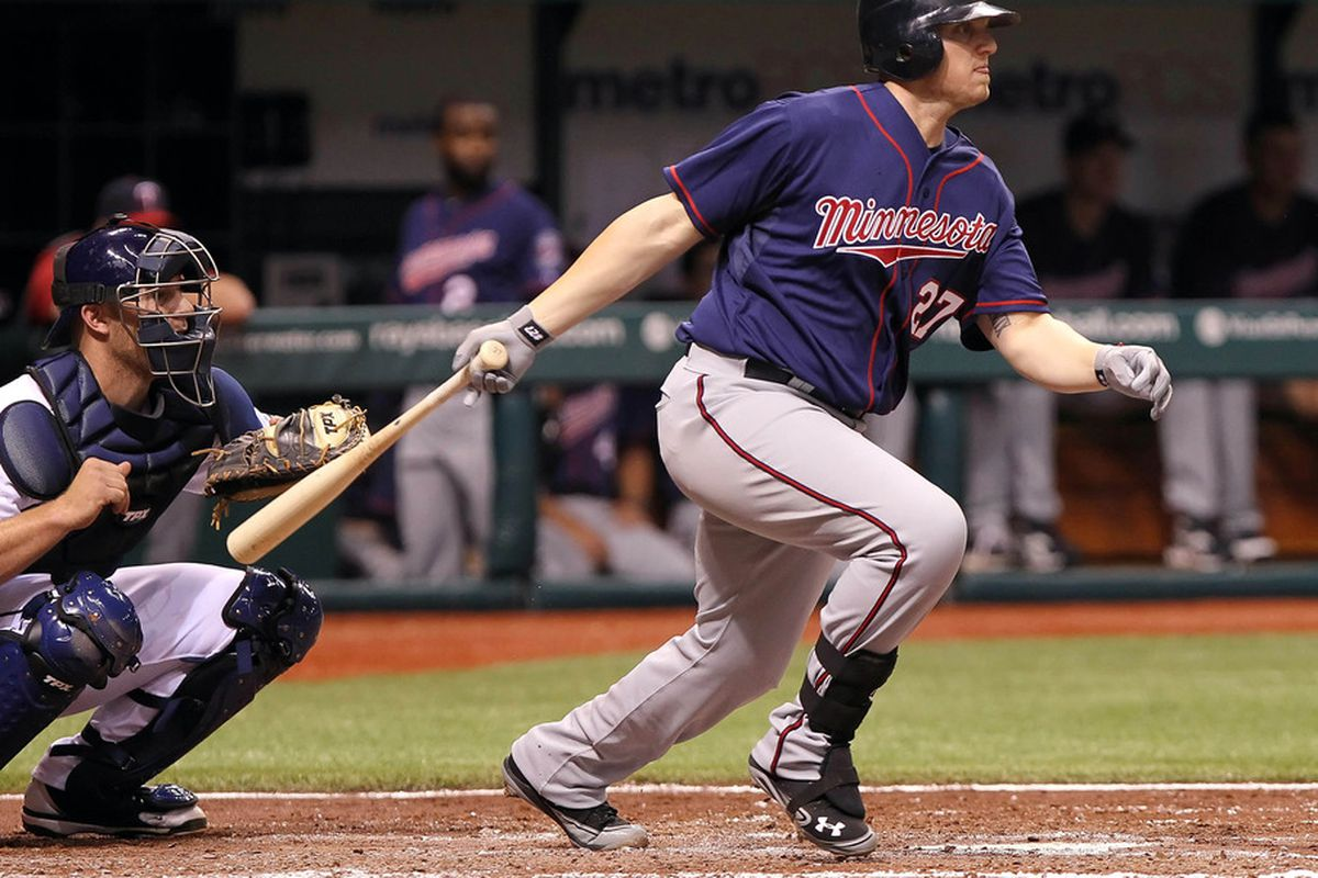 April 20, 2012; St. Petersburg, FL, USA; Minnesota Twins first baseman Chris Parmelee (27) singles in the fourth inning against the Tampa Bay Rays at Tropicana Field. Mandatory Credit: Kim Klement-US PRESSWIRE