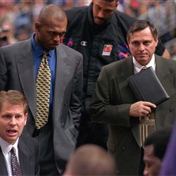 Phoenix Suns coach Danny Ainge gives instructions to his players during a timeout of the Denver Nugget game in Phoenix on Jan. 23, 1998, as assistant coaches Frank Johnson (center), and Roger Reid listen intently.