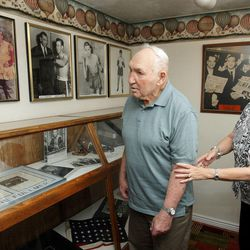 Former middleweight boxing champion Gene Fullmer and his wife Karen look over displayed items  in the West Jordan History Museum Aug. 14, 2012.
