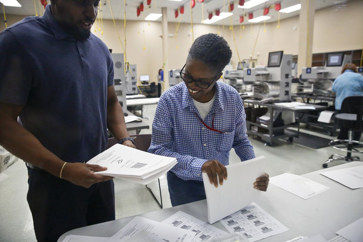 Elections staff prepare for a recount at the Broward County Supervisor of Elections office on Sunday, Nov. 11, 2018, in Lauderhill, Fla.