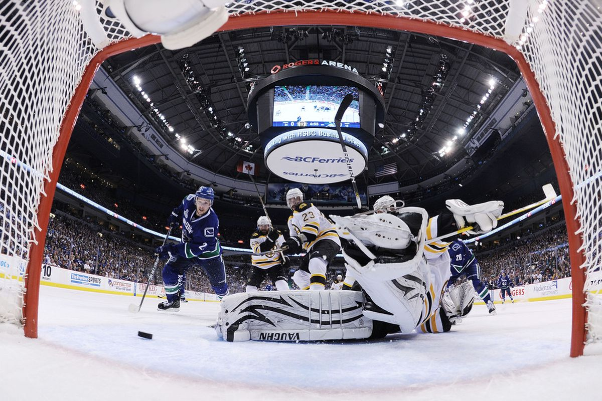 VANCOUVER, BC - JUNE 01:  Tim Thomas #30 of the Boston Bruins makes a save against the Vancouver Canucks during game one of the 2011 NHL Stanley Cup Finals at Rogers Arena on June 1, 2011 in Vancouver, Canada.  (Photo by Bruce Bennett/Getty Images)