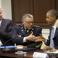 President Barack Obama shakes hands with Charles Ramsey, center, Commissioner of the Philadelphia Police Dept., following his meeting with elected officials, law enforcement officials and community and faith leaders in the Old Executive Office Building on the White House Complex in Washington, Monday, Dec. 1, 2014. Obama said that in the wake of the shooting of an unarmed 18-year-old man in Ferguson, Missouri, he wants to make sure to build better trust between police and the communities they serve. Also at the meeting are New York Mayor Bill de Blasio, left, and Laurie Robinson, right, the Clarence J. Robinson Professor of Criminology, Law, & Society at George Mason University.