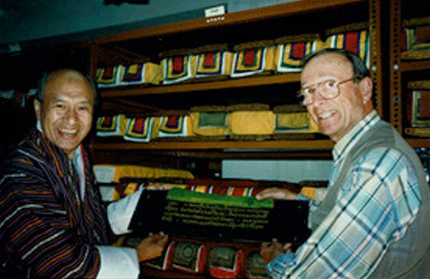 Kenneth Nebenzahl (right) visiting the director of the National Library of Thimpu, Bhutan — and his 108-volume collection of Buddha's words, each volume with carved wooden boards wrapped in silk.