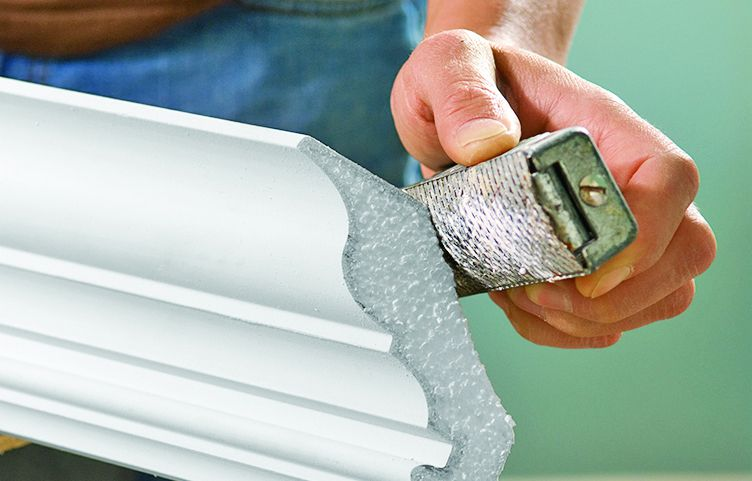 Man Uses Sanding Block To Shave Crown Molding